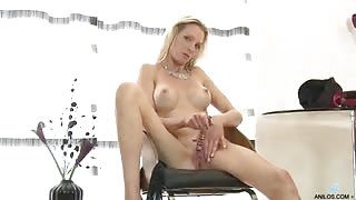 Stunning blonde milf with a slender body and sexy long legs strips out of her dress and fishnet stockings so she can give her pretty pussy immense pleasure with a glass dildo
