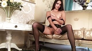 Breathtaking brunette milf shows off her hot body in thigh high stockings and then uses her fingers to make her bald pussy feel incredible tingling pleasure