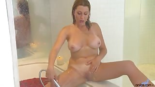 Sexy blonde mom seduces herself in a rose petal bath and uses her fingers to expertly tease her big boobs and dripping wet pussy