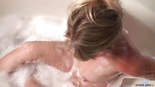 Sexy blonde cougar lathers up her nude body in the tub and fucks her dripping pussy with a vibe all the way to body-shaking orgasm