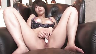 Asian using a vibrating bullet on her pussy to orgasm