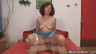 Granny grinds pussy on his cock