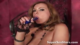 Slender blond pornstar slurps a huge dildo and plays with her juicy knockers