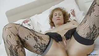 Deliciously curvy mature teases as she strips out of her bra and panties and uses her fingers to deliver intense pleasure to her craving cunt