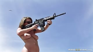 Naked pornstars shooting machine guns