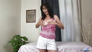 Masturbating milf plays with her tits fingering and toying her mature wet pussy