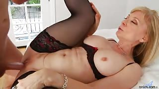 Sexy cougar Nina Hartley buries a big hard cock deep in her mouth before taking it all in her sweet shaved snatch