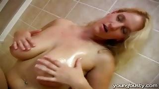 Big titted girl in the bathroom