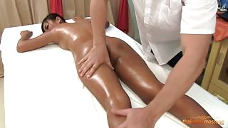 Thai fuck doll oiled up naked and massaged