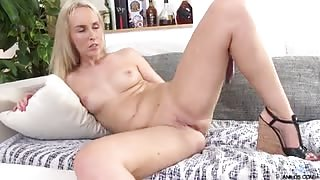 Luscious european blonde Jenny Simmons slowly strips out of her white dress. She begins playing with her firm tits and teasing her soft pussy. She gets her glass toy all wet in her mouth before inserting it in her pussy to reach orgasmic pleasures.