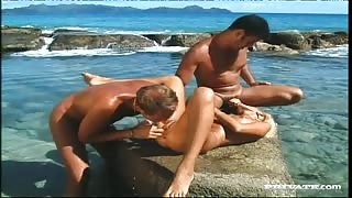 Blonde Suzan Gets Fucked by Two Men While Playing in the Ocean