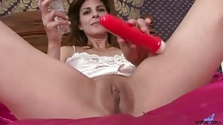 Horny Mature Anilos Monique gently shoves a stiff dildo into her shaved mature pussy