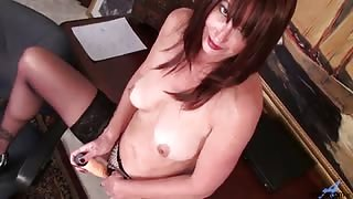 Voluptuous auburn haired cougar finds a vibrator in her co-workers desk and cant resist sliding it in her pussy for a body shaking orgasm